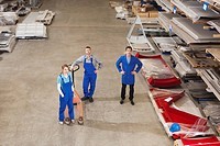 Germany, Neukirch, Instructor and apprentices standing in industrial hall, elevated view