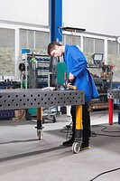 Germany, Neukirch, Apprentice working on work bench