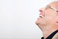 Businessman laughing, eyes closed, portrait