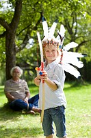 Disguised boy with toy bow and arrows