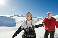 Italy, South Tyrol, Seiseralm, Senior couple in winter scenery