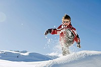Italy, South Tyrol, Seiseralm, Boy 4_5 playing in snow