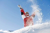 Italy, South Tyrol, Seiseralm, Boy 4_5 playing in snow, cheering, low angle view