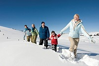 Italy, South Tyrol, Seiseralm, Family walking in snow