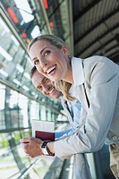 Germany, Leipzig_Halle, Airport, Businessman and businesswoman, laughing, portrait