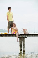 Germany, Bavaria, Ammersee,Young couple on jetty, portrait