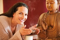 Portrait of a woman, buddha statue in background (thumbnail)