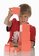 Boy 8_9 playing with building bricks