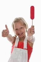 Girl 10_11 holding lollypop, rejoicing, thumbs up, portrait