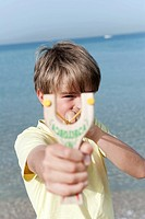 Spain, Mallorca, Boy 8_9 using sling_shot