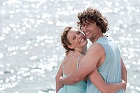 Spain, Mallorca, Couple standing at ocean, embracing