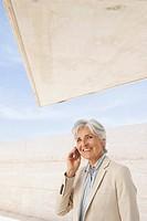 Spain, Mallorca, Senior Businesswoman using mobile phone