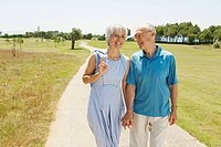 Spain, Mallorca, Senior couple having a walk, portrait
