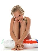 Girl 10_11 sitting on floating tire, portrait