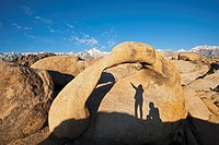 USA, California, Sierra Nevada, Mobius arch, Shadow of two persons in foreground