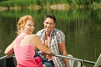Italy, South Tyrol, Couple in rowing boat, smiling, portrait