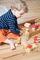 Germany, Berlin, Boy 3_4 playing with building bricks