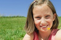Italy, South Tyrol, Seiseralm, Girl 10_11 with flower in mouth, portrait, close_up