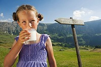 Italy, South Tyrol, Seiseralm, Girl 6_7 holding a glass of milk, portrait