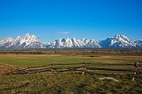 USA, Wyoming, Wooden fence in foreground, in background Teton Range mountains
