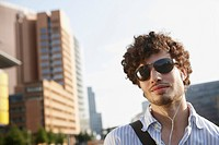Germany, Berlin, Young man wearing sunglasses, portrait