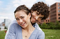 Germany, Berlin, Young couple, smiling, portrait