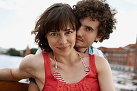 Germany, Berlin, Young couple on motorboat, portrait, close_up