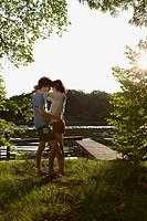 Germany, Berlin, Spree river, Young Couple embracing