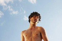 Germany, Berlin, Barechested man, portrait, low angle view