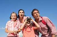 Italy, South Tyrol, Family with children 6_7 10_11, girl looking through binoculars, portrait