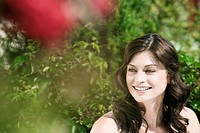 Italy, South Tyrol, Portrait of a woman in garden, smiling, close_up