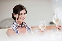 Couple in restaurant toasting wine glasses