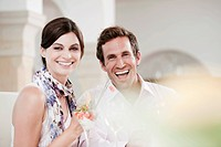 Couple in restaurant, laughing, portrait