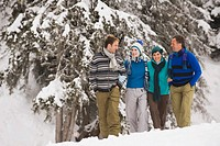 Italy, South Tyrol, Young people taking a winter walk