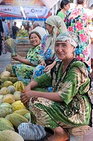 Market women selling pumpkins, Khojand, Tajikistan, Central Asia, Asia
