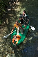 Austria, Salzburger Land, Family on a creek, canoeing, elevated view