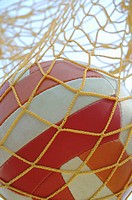 Germany, Bavaria, Close_up of a soccer ball in a net