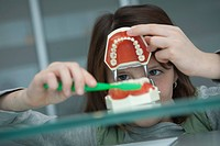 Germany, Bavaria, Landsberg, Girl 8_9 in dental surgery
