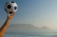 Africa, South Africa, Kapstadt, Person holding soccer ball, close_up