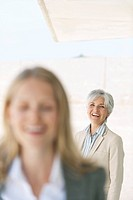 Spain, Mallorca, Two businesswomen, laughing