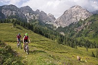 Italy, Dolomites, Couple mountainbiking