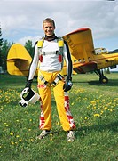 Parachute jumper in front of a plane