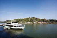 Germany, Rhineland_Palatinate, A tourboat in front of the fortress Ehrenbreitstein