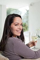 Young woman with glass of wine (thumbnail)