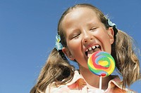 Italy, South Tyrol, Girl 6_7 licking lollypop, portrait, close_up