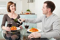 Couple having meal and wine