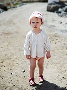 Europe, Spain, Canary Islands, Tenerife, Girl 2_3 wearing hat on beach, close_up