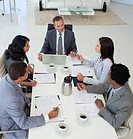 High angle of Multi_ethnic business people discussing in office a plan