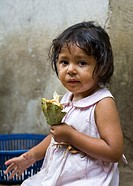 Young girl eating raw cacao