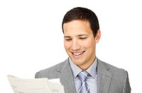 Smiling businessman reading a newspaper isolated on a white background